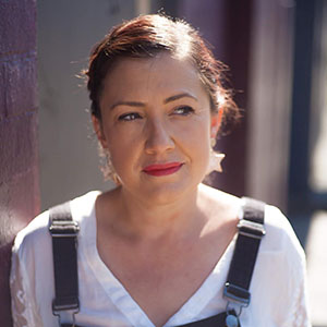 This is a photograph of Angela Peita who will be part of the Logan heat of the Australian Poetry Slam.