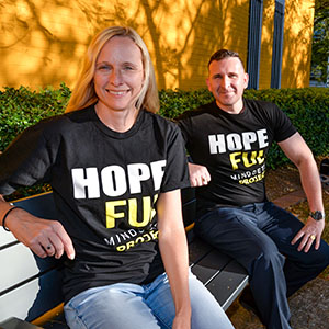 An image of Logan City Councillors Miriam Stemp and Tony Hall wearing special t-shirts that encourage the community to embrace Mental Health Week activities in the City of Logan.