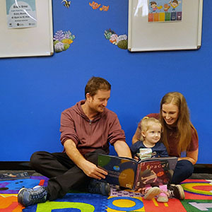 This is an image of a Logan family reading the featured story for National Simultaneous Storytime,