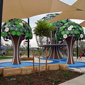 An image of the treehouse structures at the Flagstone water play area.