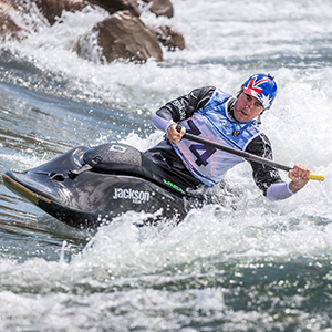 An image of Three-time World Cup freestyle kayak champion Jez Blanchard paddling through rapids. Blanchard has endorsed plans to build a world-class whitewater facility in Logan. Photo courtesy of Peter Holcombe