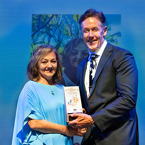 A photograph of City of Logan 2021 Citizen of the Year Anita Anderson with Logan Mayor Darren Power.