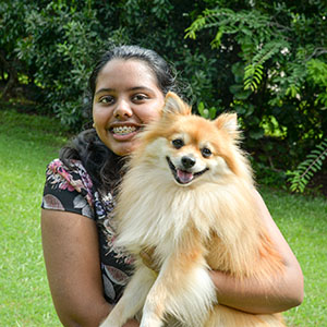 A picture of Boronia Heights teenager and City of Logan Young Citizen of the Year Juliet Thottunkal, with dog Simba.