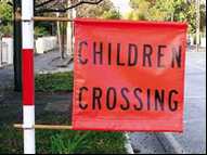 picture of a children's crossing flat that indicated children crossing during school times