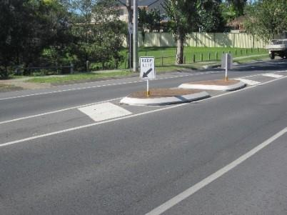 picture of a traffic island refuge in the middle of the road to help cross the road
