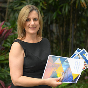 Councillor Lisa Bradley with the new documents endorsed by Logan City Council.